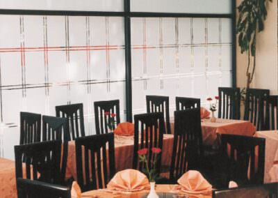 Shapes from matte decorative film on restaurant glass walls